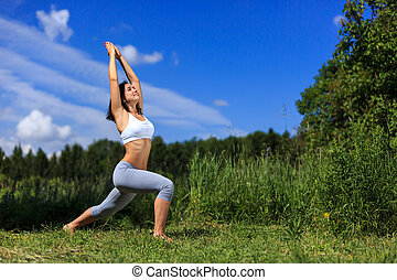 girl doing yoga outdoor and smiling, ladscape