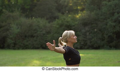 young woman doing yoga outdoors - young sporty woman doing...