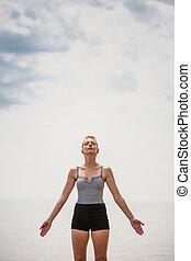 Young Woman doing Yoga Position