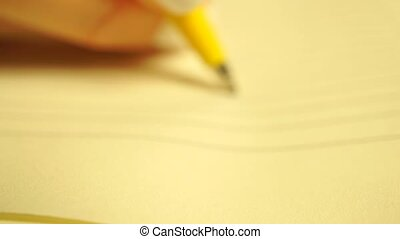 Young woman drawing a smiley in her planner. Shallow focus...