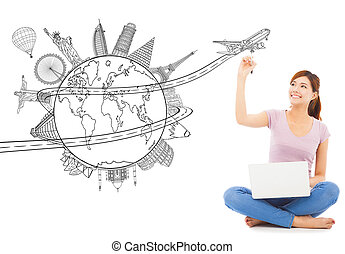 young woman drawing a travel trip planning