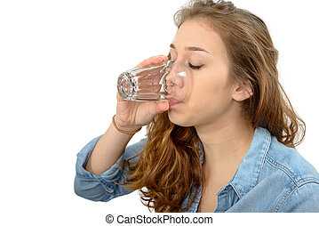 young woman drinking a glass of water, on white