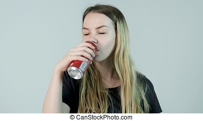 Young woman drinking a soda.Young beautiful woman drinking...