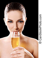 Young woman drinking champagne