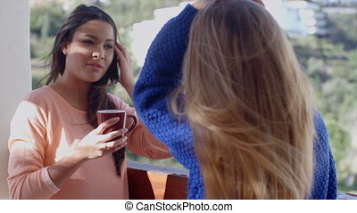 Young woman drinking coffee and using a mobile - Young woman...