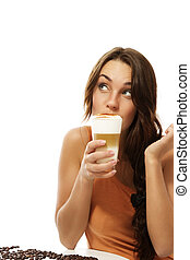 young woman drinking latte macchiato coffee looking up on ...
