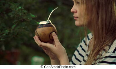 Young woman drinking mate outdoor