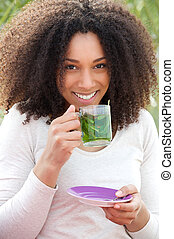 Young woman drinking mint tea
