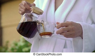 Young woman drinking tea from cup in the morning. Breakfast at home