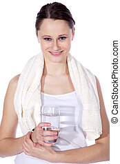 young woman drinking water at sport