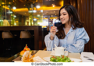 woman drinking wine in the restaurant