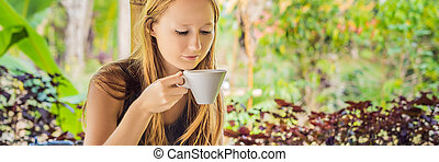Young woman drinks coffee Luwak in the gazebo BANNER, long format