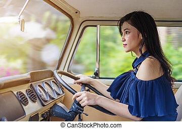 woman driving a vintage car
