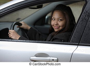 Young woman driving her new car.