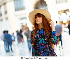 Young woman during a walk in the center of Naples.