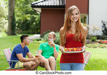 Young woman during garden party