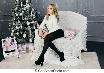 Young woman during preparations for Christmas at home