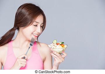 woman eat salad and smile