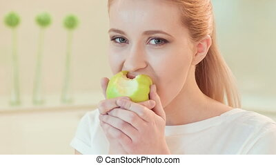 young woman eating apple. Organic food