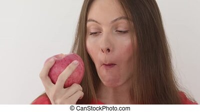 Young woman eating big red apple Healthy nutrition
