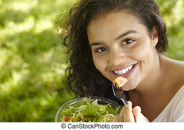 Young Woman Eating Healthy Salad Outdoors
