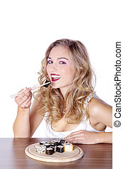 young woman eating sushi
