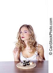 young woman eating sushi