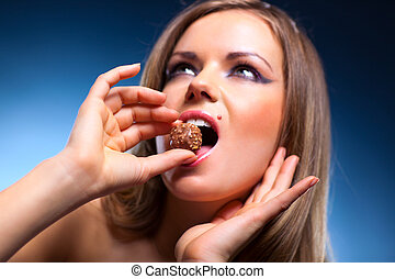 Young woman eating sweet portrait