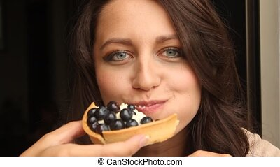 Young Woman Eating the cake