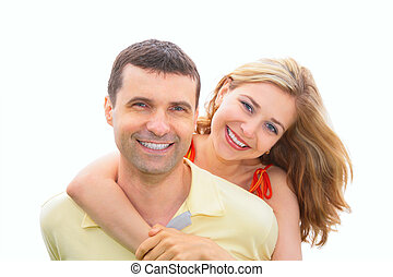 young woman embraces man behind