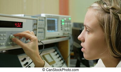 Young woman engineer student working in the lab with...