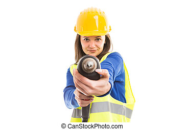 Young woman engineer using drilling machine