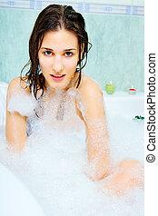 woman enjoy in bathtub with foam