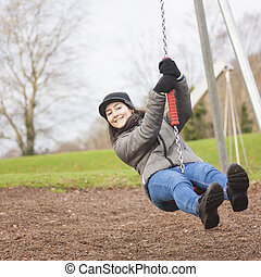 Young woman enjoy in the playground