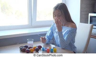 Young woman enjoy painting on fantasy eggs for Easter egg ...