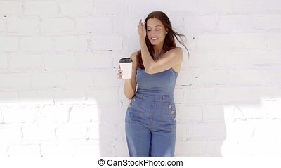 Young woman enjoying a cup of takeaway coffee