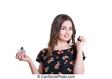young woman enjoying a smell of the perfume