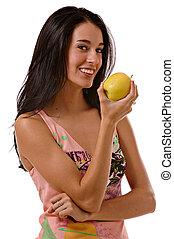 young woman enjoying an apple