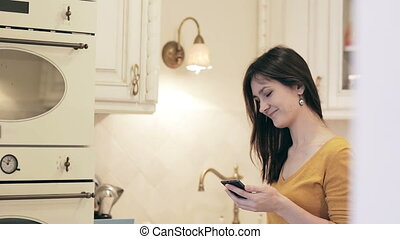 Young woman enjoying coffee on a bright kitchen
