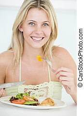 Young Woman Enjoying Healthy meal, mealtime