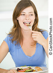 Young Woman Enjoying meal, mealtime