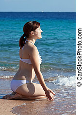 woman enjoying  on sand beach