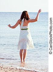 woman enjoying  on  sea  beach