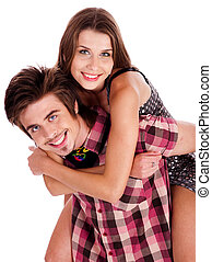 Young woman enjoying piggyback ride
