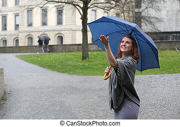 young woman enjoying rain
