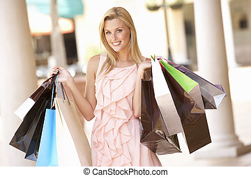Young Woman Enjoying Shopping Trip