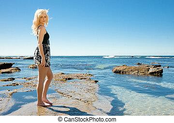 young woman enjoying summer at beach