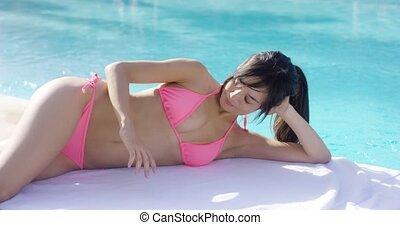 Young woman enjoying the summer sun