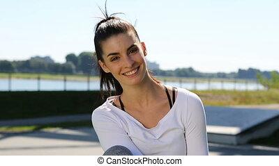 young woman enjoying the sun at the park