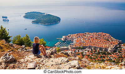 young woman enjoying the view of the Dubrovnik Old Town